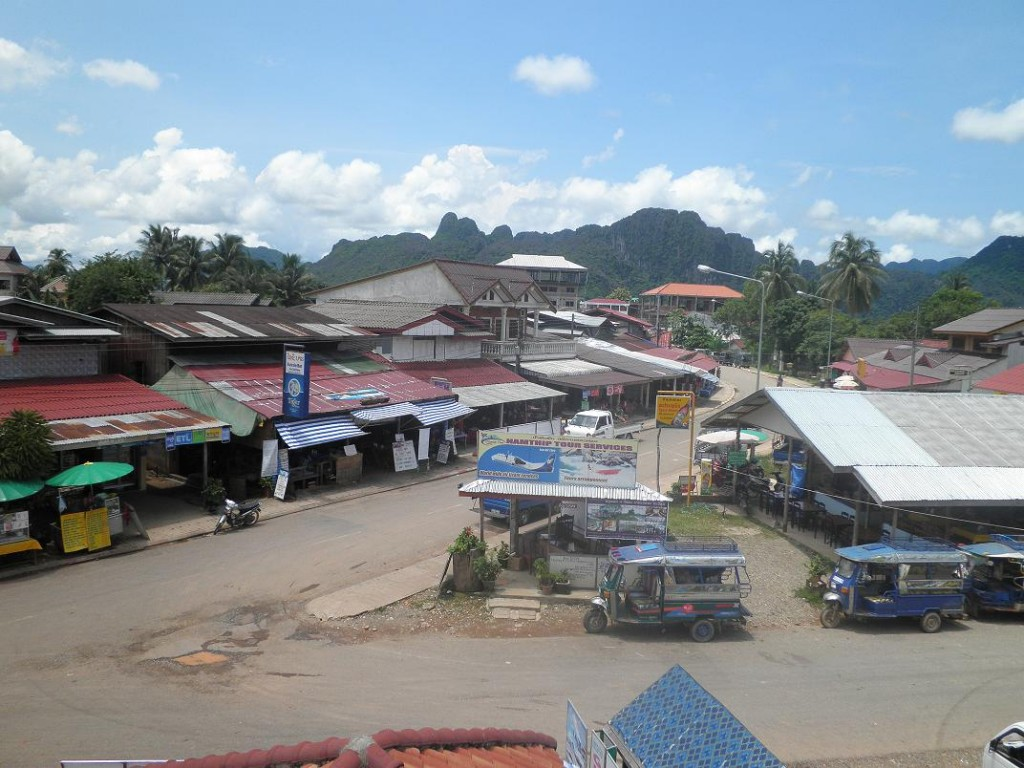 Downtown junction in Vang Vieng, by Jorn Koelemaij