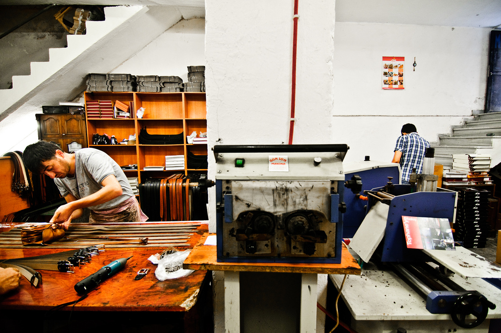 Two young men hard at work in a belt-making shop in Istanbul (Photo: Adam Nowek)
