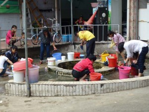 Countryside meets city: washing clothes in the village well