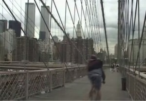 Film still from Pedal, 2001. Bike messenger on the Brooklyn Bridge