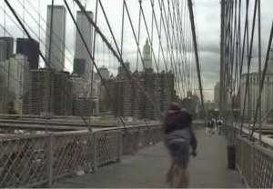 Film still from Pedal, 2001. Bike messenger on the Brooklyn Bridge