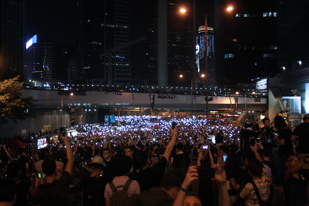 Protestors illuminate the streets with their mobile phones in defiance of police requests to disperse (Photo: Isabella Rossen)
