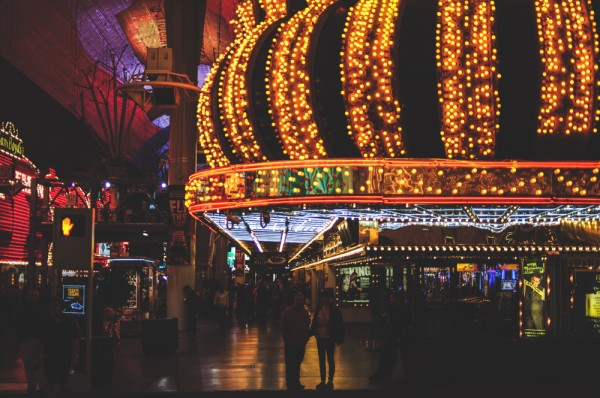 Visitors stroll along the Fremont Street Experience by night (Photo: Adam Nowek)