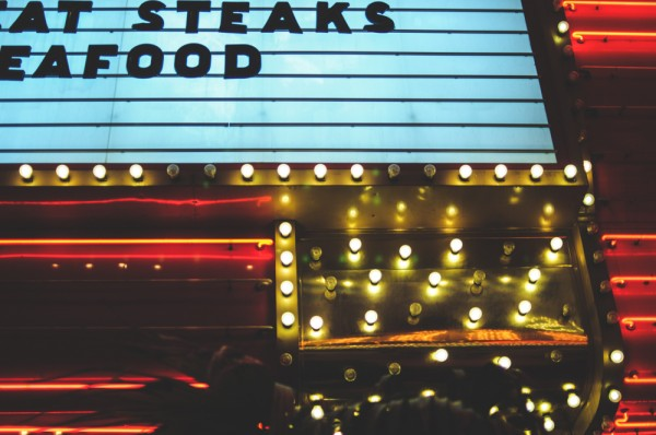 Food advertising on a neon marquee (Photo: Adam Nowek)