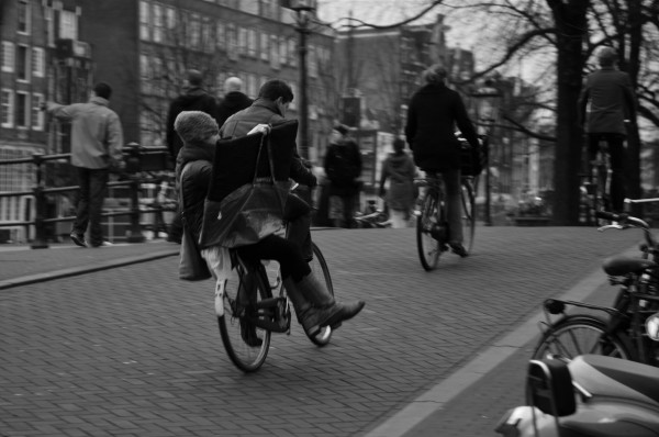 Although Amsterdam is generally flat, climbing the steep bridges may be challenging for UberCyclists - picture by Amsterdamized, Flickr