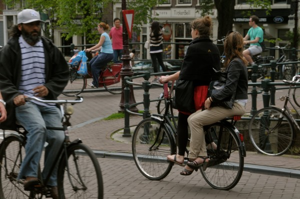 While being prohibited in many countries, sitting on the back of someone's bike has been part of Holland's cycling culture for centuries. Picture by Amsterdamized, Flickr