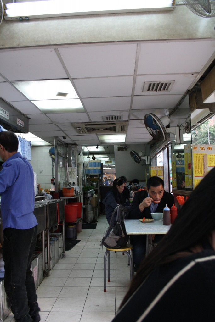 "One of the few remaining old congee shops in Kennedy Town. Congee is a local-style porridge made of rice. A middle-aged resident recalls how his mum or grandmother would take him there ""because as Chinese, you know when you are sick you don't eat rice, you eat congee"" (Photo: Isabella Rossen)"