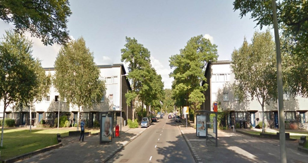 (source Google Streetview 2015): Bus stops in Geuzenveld that will be soon removed, located in Gerda Brautigamstraat. The orange cover (right) which indicates its imminent removal has been taken out by local residents several times.
