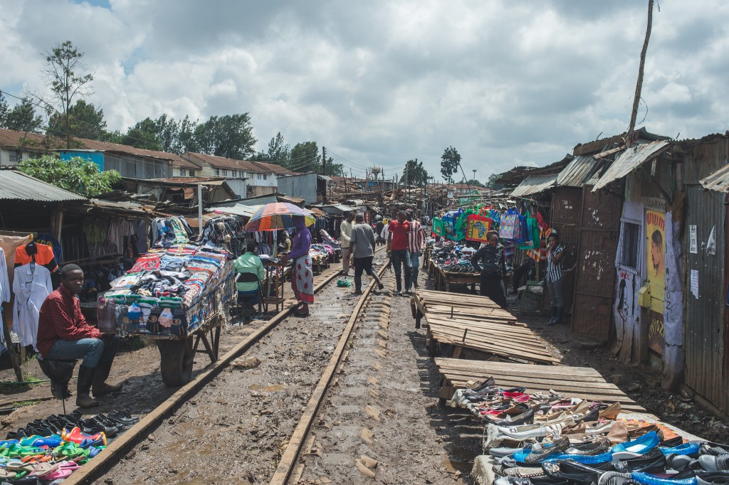 Sellers hawking their wares alongside active train tracks (Photo: Adam Nowek)