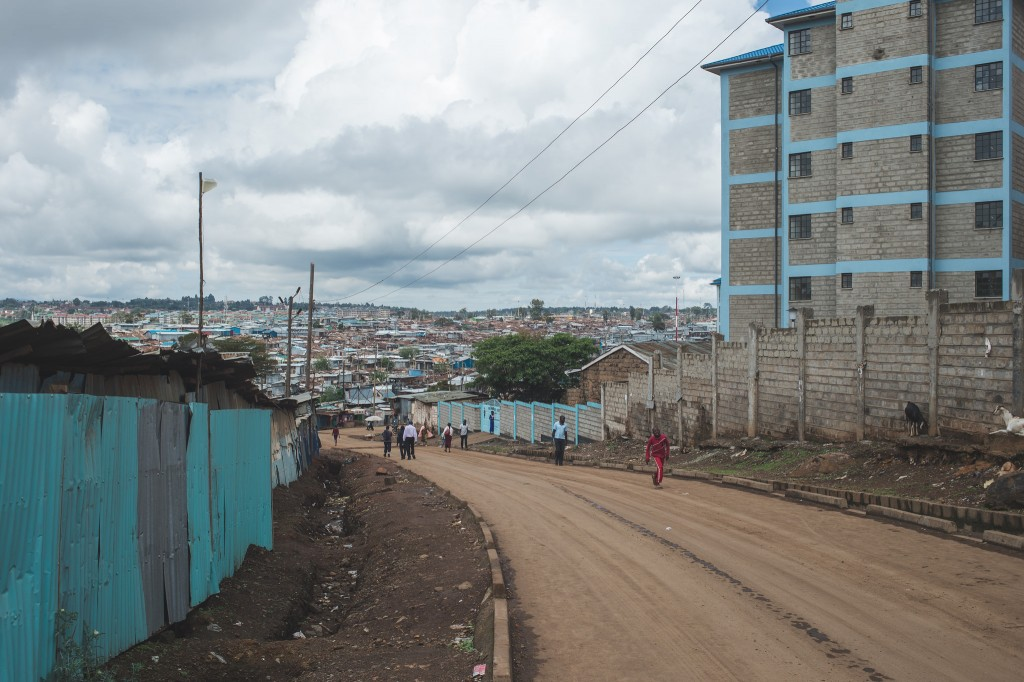 A road leading into Kibera with government-built flats visible on the right (Photo: Adam Nowek)