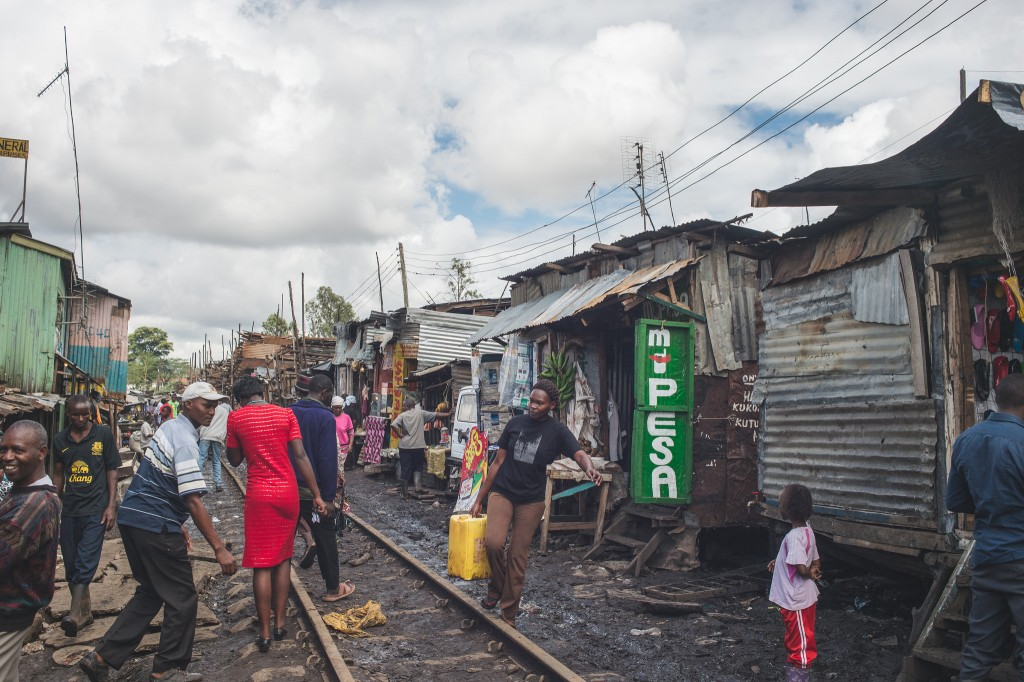 A train track runs along a major pedestrian thoroughfare in Kibera (Photo: Adam Nowek)