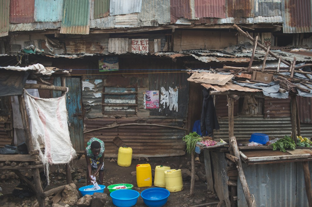 A Kibera resident doing the wash (Photo: Adam Nowek)