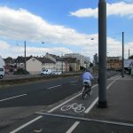 Cycling along the highway, typical for Automative Cities (own picture)