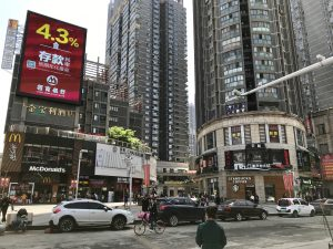New apartments and shops near Zhongshan Avenue, featuring global chains like McDonald's and Starbucks (Photo: Carl Hooks)